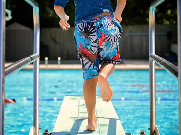 Boy Jumps off Diving Board, Austin, Texas